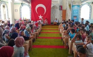 Hassa'da Kur'an kursu öğrencilerine hediye dağıtıldı