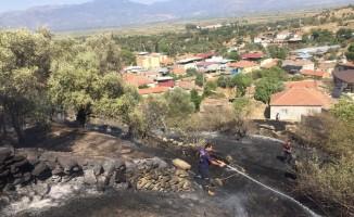 Yenipazar'daki yangın evlere sıçramadan söndürüldü