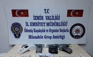 İzmir'de iş yerine yapılan operasyonda ele geçirilenler şoke etti