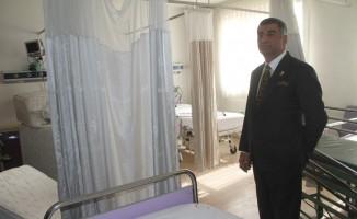 Milletvekili Erol, içi boşaltılmaya başlanan hastanede inceleme yaptı