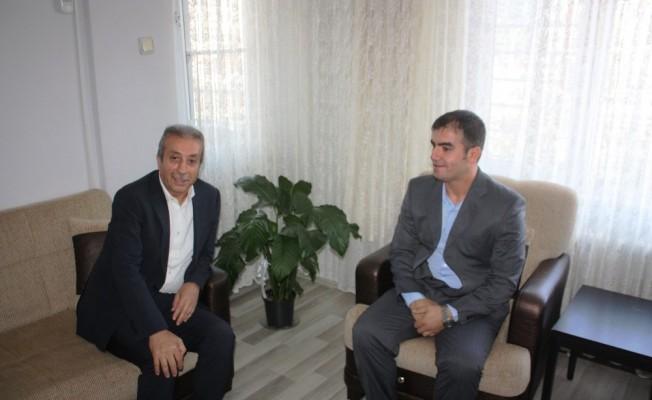 AK Parti'li Eker, 15 Temmuz gazisini evinde ziyaret etti