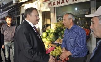 Eroğlu'dan Şuhut çarşı esnafına ziyaret