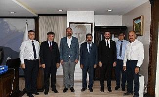 Başkan Gümrükçü'ye İKÇÜ heyetinden ziyaret
