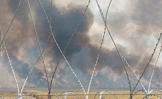 Suriye'de çıkan yangın Türkiye sınırına dayandı